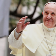 Pope Francis waves to thousands of followers as he arrives at the Manila Cathedral on January 16, 2015 in Manila, Philippines.