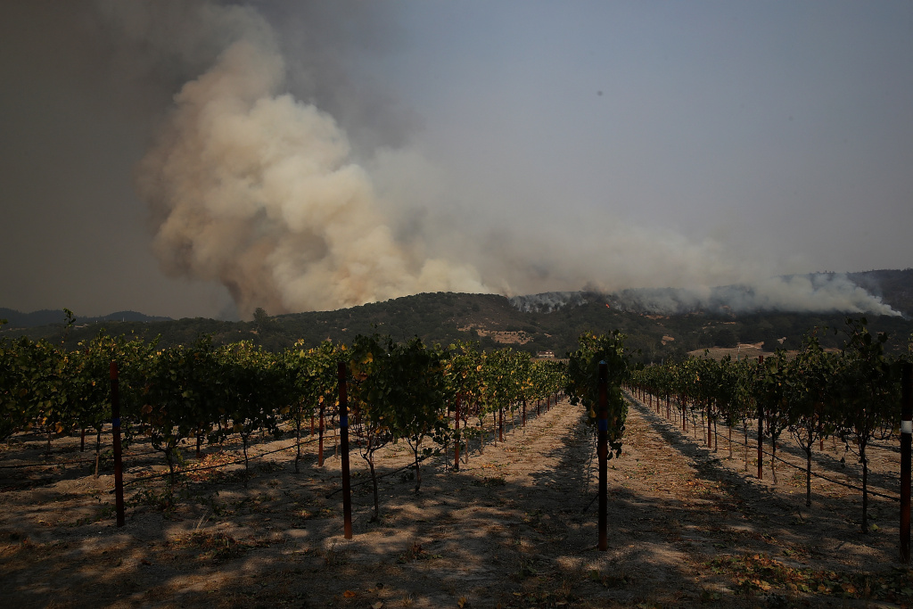 An out of control wildfire approaches Gundlach Bundschu winery on October 9, 2017 in Sonoma, California.