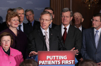 Flanked by Senate Democrats, Senate Majority Leader Harry Reid (D-NV) (C) speaks after a vote on health care on Capitol Hill on March 25, 2010 in Washington, DC. The Senate approved the health care bill with by a 56-43 margin and sent it to the House for a final vote.