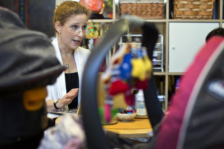 Dr. Natalie Nevins visits a newborn in her Hollywood wellness center.