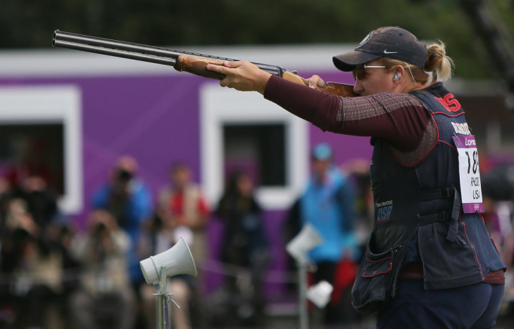 Kimberly Rhode of the United States poses with her gold medal at a press conference at The Main Press Center after winning the Women's Skeet Shooting on Day 2 on of the London 2012 Olympic Games at The Royal Artillery Barracks on July 29, 2012 in London, England.