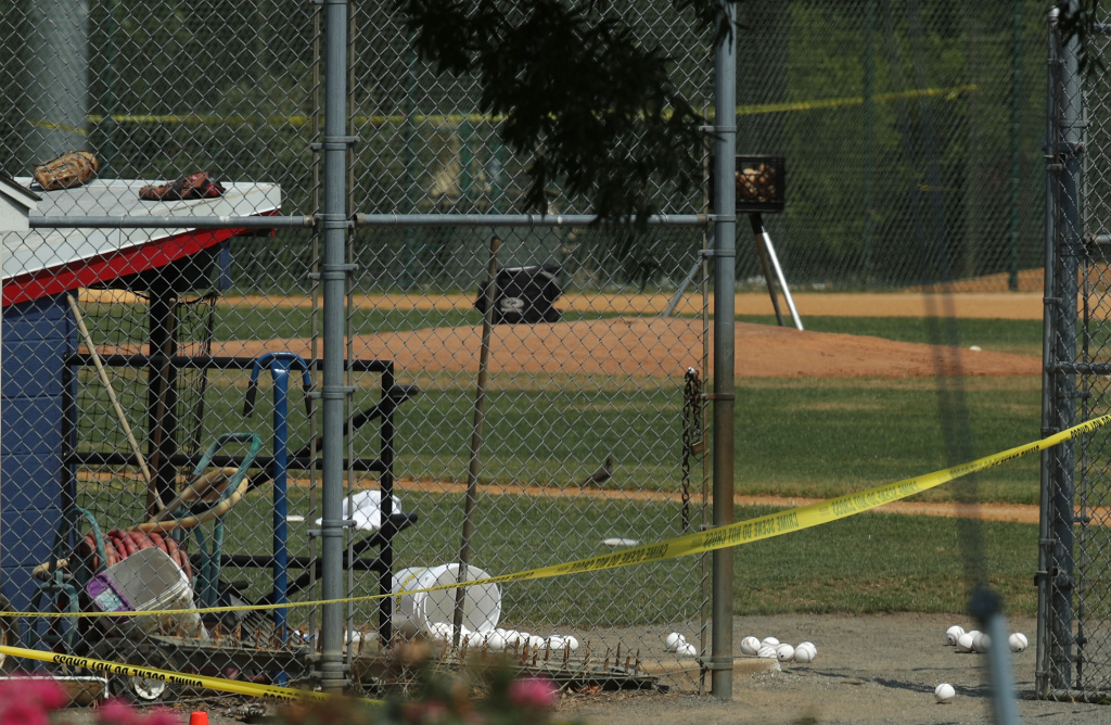 Baseballs are left behind by the dugout area at the Eugene Simpson Stadium Park where a shooting had happened June 14, 2017 in Alexandria, Virginia.