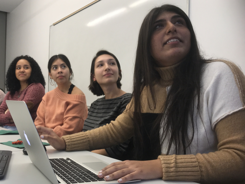 (From left) Daniela Lebron, 18; Jennifer Lopez, 17; Klea Kalia, 21; and Yasmin Butt, 21, attend an event at Barnard College in New York City for Latino, first-generation and low-income students interested in studying abroad.