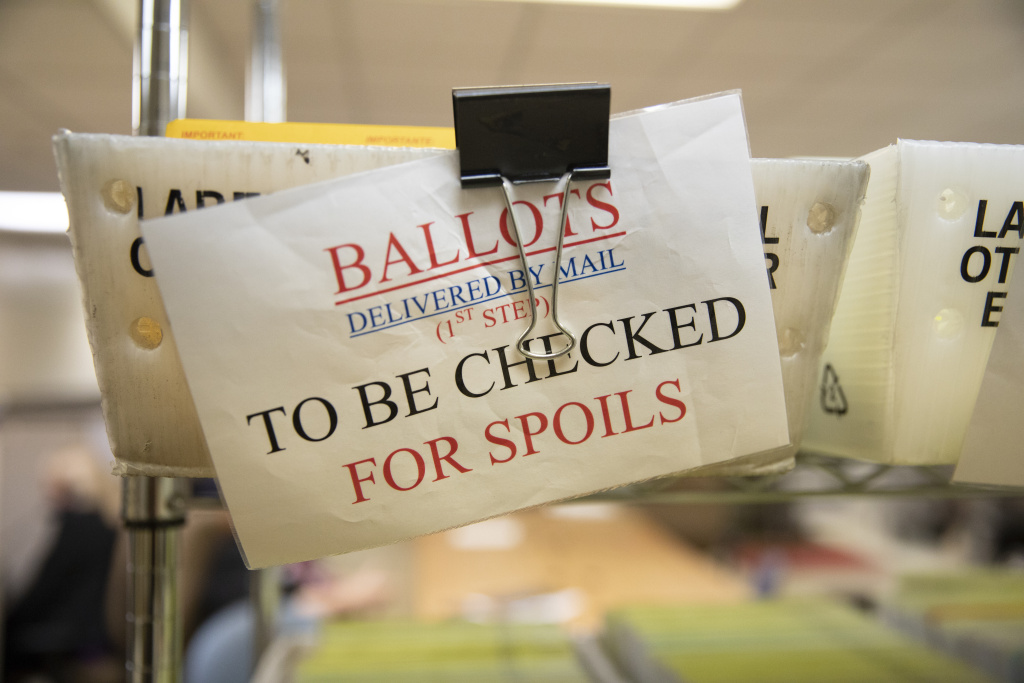 Mailed in ballots sit in US Postal Service bins inside the office of the Stanislaus County Clerk on November 6, 2018 in Modesto, California.
