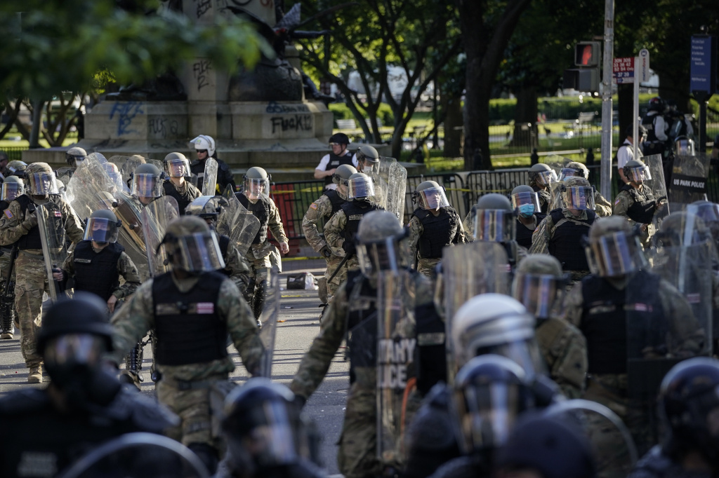 Law enforcement gathered to remove demonstrators from the area around Lafayette Park and the White House ahead of President Trump's trip to St. John's Church on June 1.