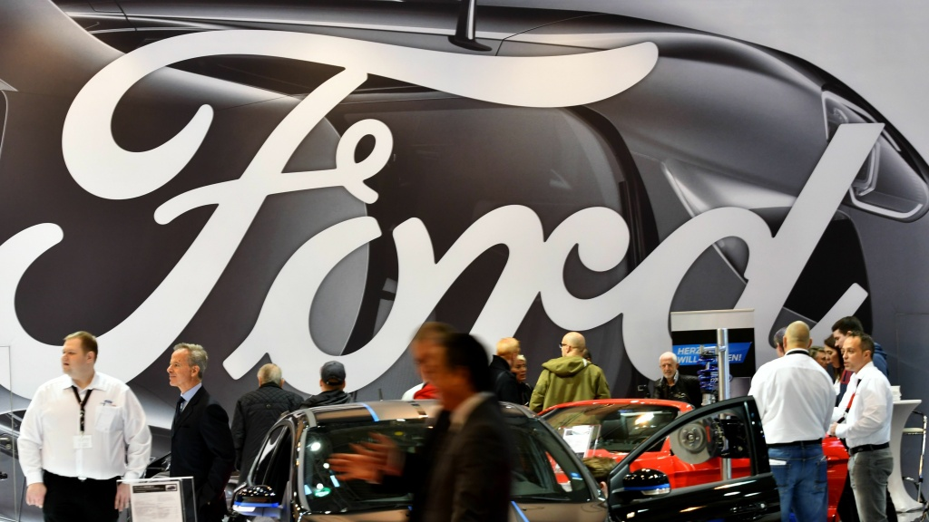 People at the Ford display at the Essen Motor Show fair in Essen, Germany, in December 2017. The automaker has announced it will be cutting some jobs in Europe to reduce costs.