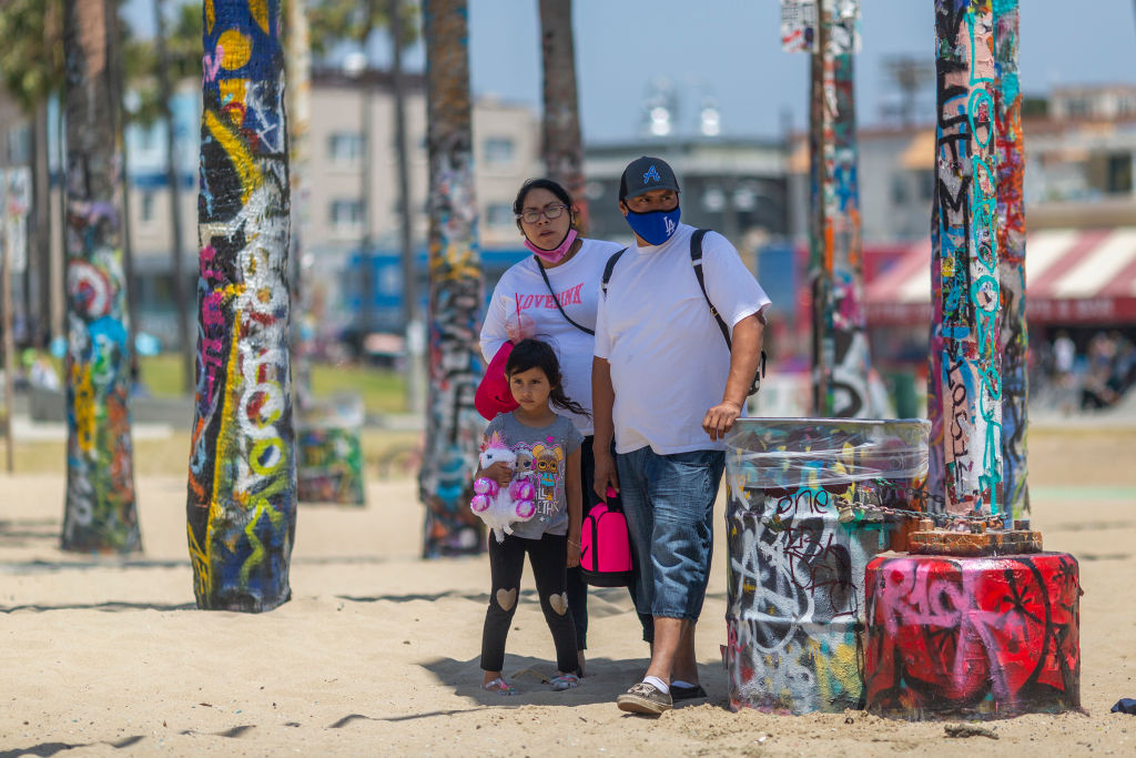 Holiday beachgoers visit Venice Beach on Memorial Day in Los Angeles County and nationwide on May 24, 2020 in Los Angeles, California.