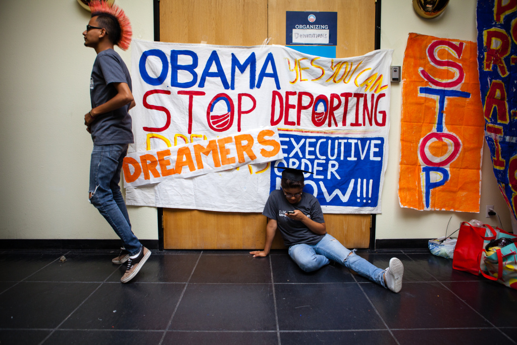 Antonio Cabrera and Jahel Campos pass the time on their second day of occupying the lobby in front of Obama's campaign office in Culver City, CA. Though the president announced a plan to defer deportations of undocumented youth, Cabrera and the other protesters feel that this isn't a strong enough action.