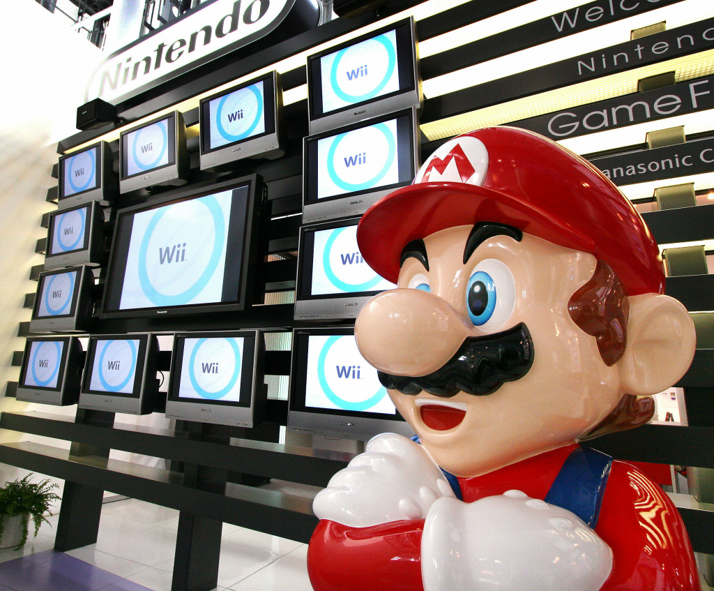 Japanese video game giant Nintendo's game character Super Mario stands at a showroom in Tokyo 25 January 2007. Nintendo said that its net profit rose more than 43 percent in the three quarters to December as video-game fans worldwide snatched up its DS portable game machines and next-generation Wii machines.
