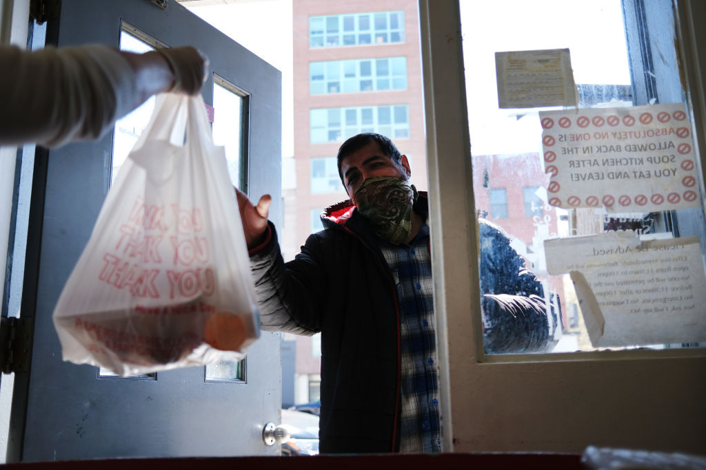 People receive food at a food bank on April 28, 2020 in the Brooklyn borough of New York City.