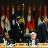 US President Barack Obama (C) walks past