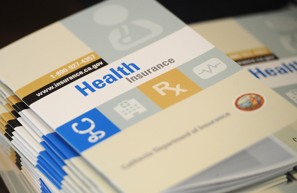 Booklets outlining health insurance options at a September resource fair in South Gate.