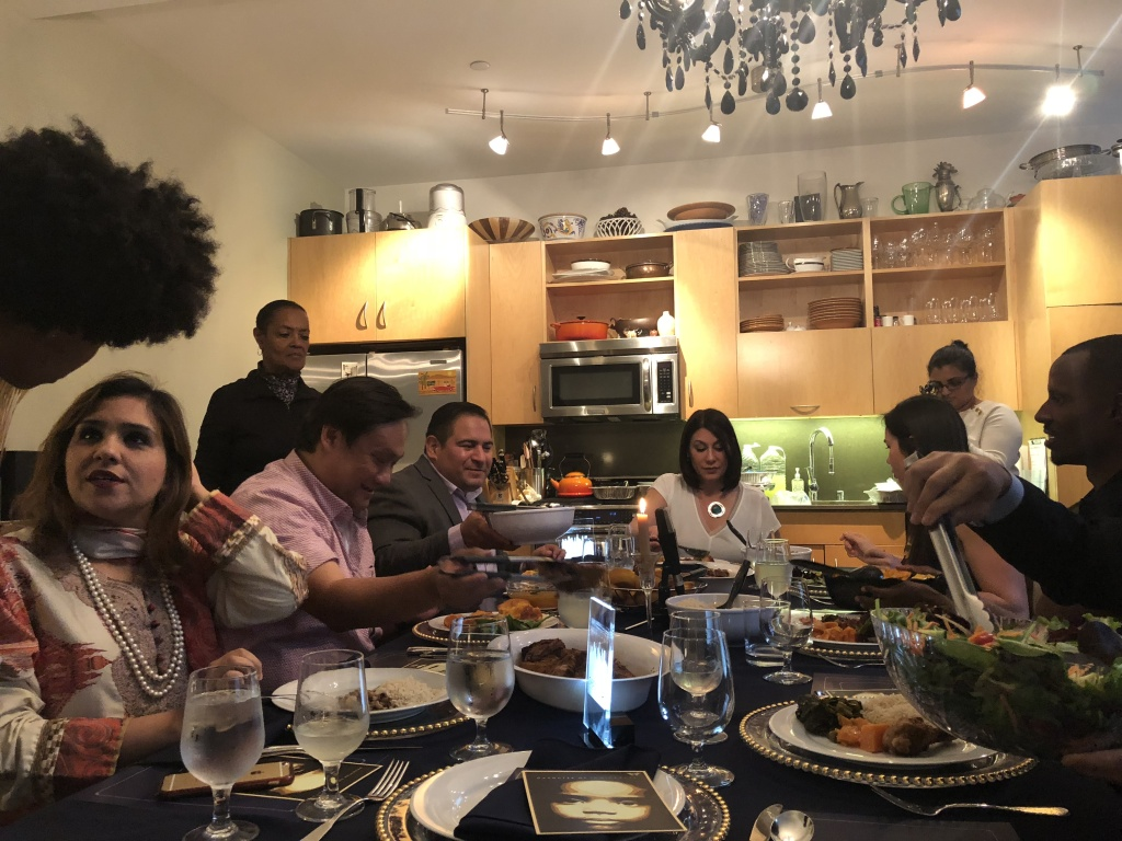 Left to right, at dinner table: Amna Qazi, Tom Chang, Ernesto Hidalgo, Veronica Perez, Emily Coldiron, Anthony Foster