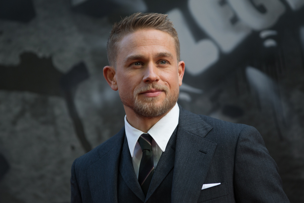 British actor Charlie Hunnam poses for a photograph upon arrival at the European Premiere of