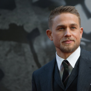 "British actor Charlie Hunnam poses for a photograph upon arrival at the European Premiere of ""King Arthur: legend of the Sword"" in London on May 10, 2017."
