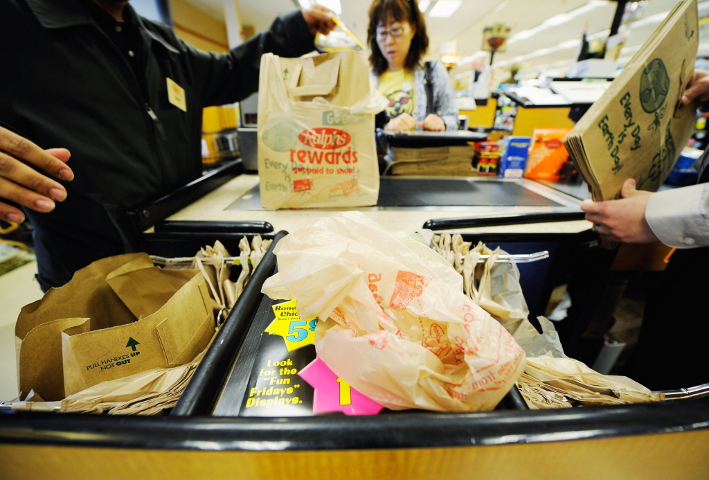 File photo: Customers of Ralphs supermarket use plastic bags to carry their groceries home on October 25, 2011 in Glendale.