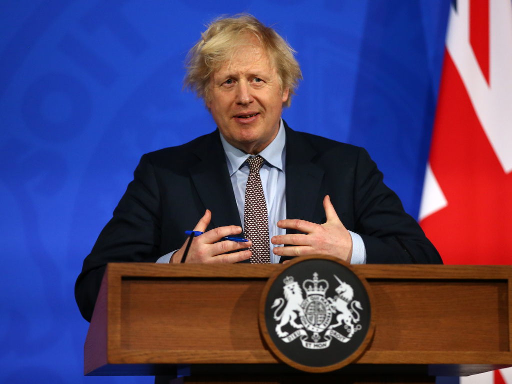 Britain's Prime Minister Boris Johnson gives an update on the coronavirus pandemic during a virtual news conference in London on Monday. Johnson and other world leaders signed a letter calling for greater international cooperation in fighting future pandemics.