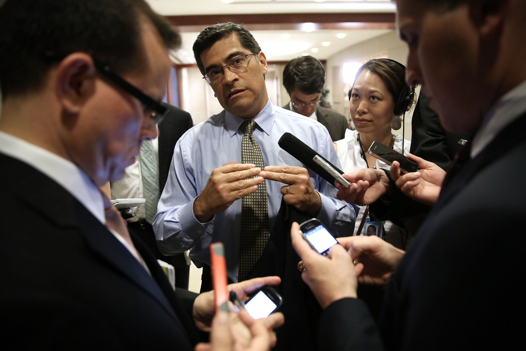 FILE PHOTO. U.S. Rep. Xavier Becerra speaks to the media as he arrives at a briefing for members of the House of Representatives June 11, 2013 on Capitol Hill. The list of candidates seeking his seat has grown longer following his nomination as California attorney general.
