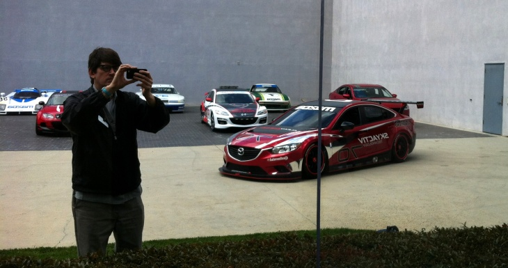 Off-Ramp host John Rabe with a mockup of Mazda's diesel racecar at Mazda R&D in Irvine.