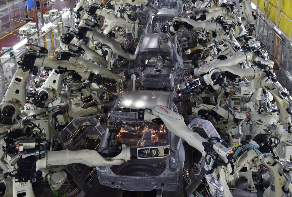 A general view shows the body welding workshop which uses automated welding machine robots that assemble automobile bodies