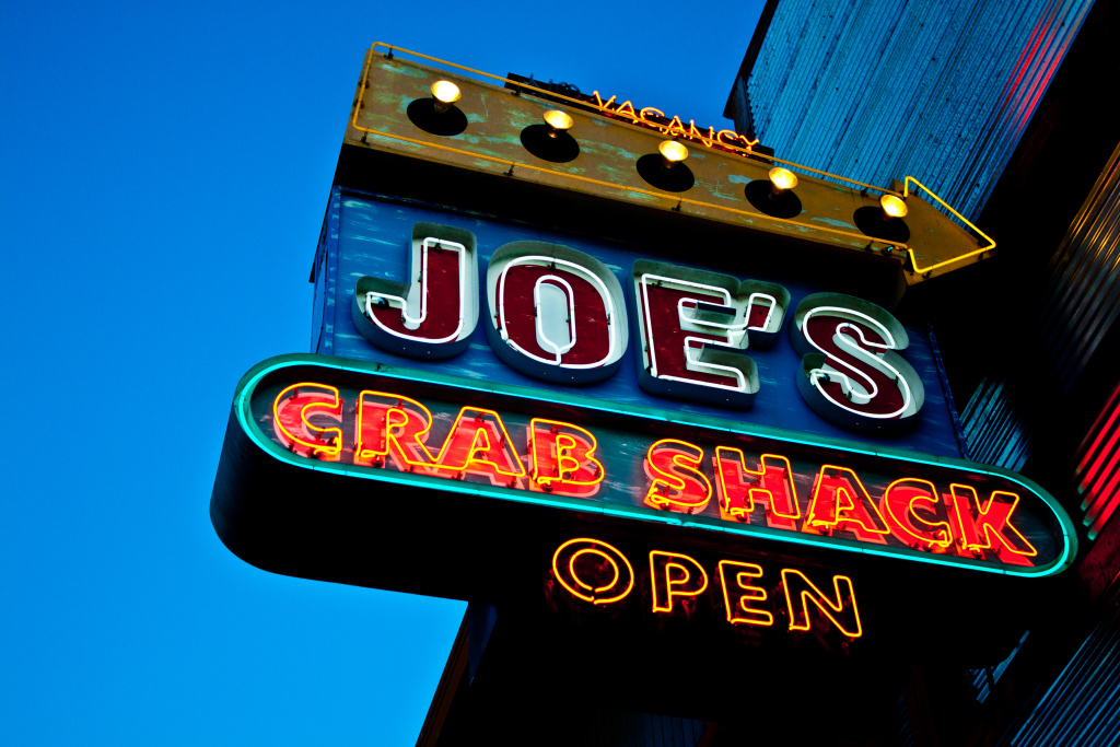 A sign for Joe's Crab Shack is seen in San Francisco, California in this file photo. The restaurant has been piloting a no-tipping policy at 18 of its locations around the U.S.