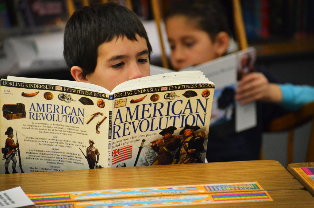 Fourth-grader Isiah Soto digesting some history during independent reading time.