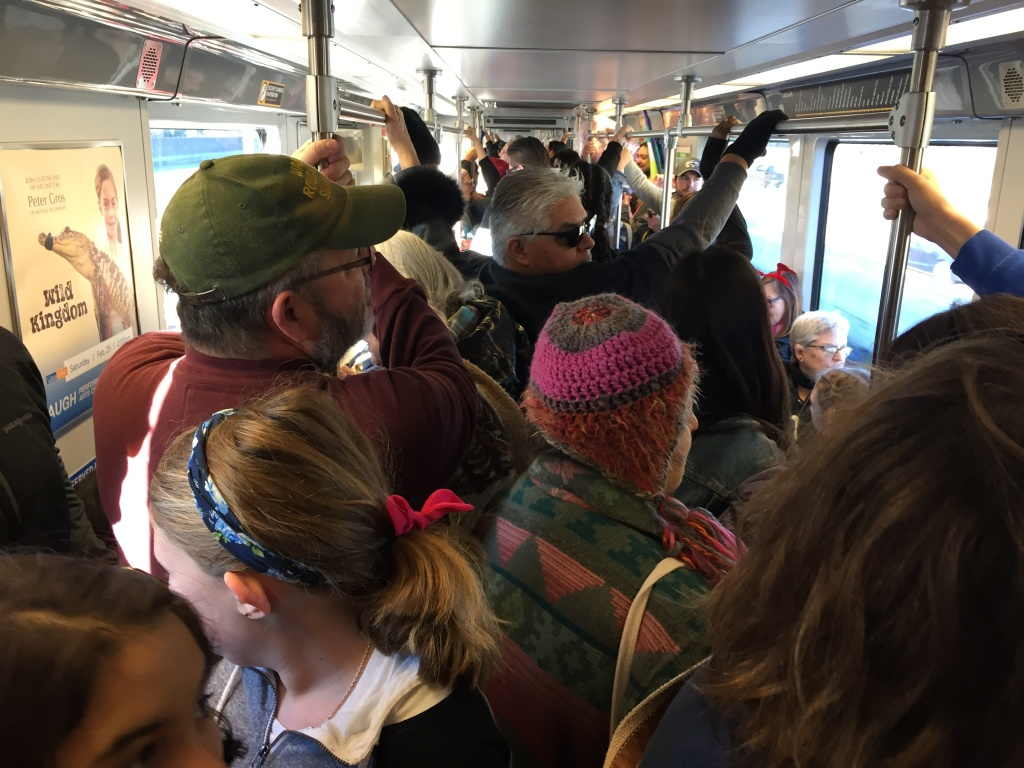 Metro riders, many headed to the Women's March in downtown Los Angeles, fill a train on the Gold Line at 8:30 a.m. Saturday, Jan. 21, 2017.