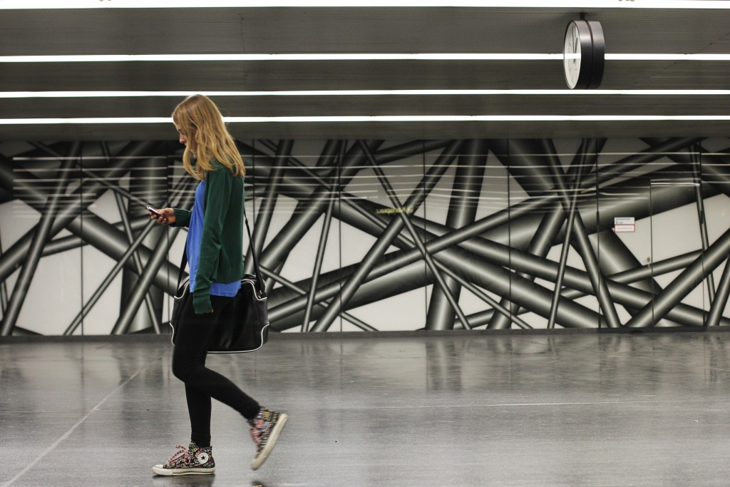 A girl holds a mobile phone as she walks in Vienna on May 8, 2012.