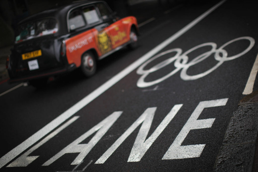 A taxi drives past an Olympic Lane marking on the Embankment on July 16, 2012 in London, England. The first Olympic lanes were due to be closed to all but Olympic traffic in London today, though many have stayed open.