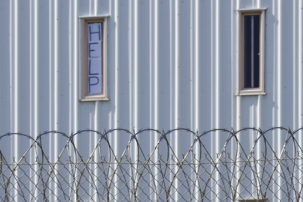 A sign placed in the window of an inmate's cell calls for