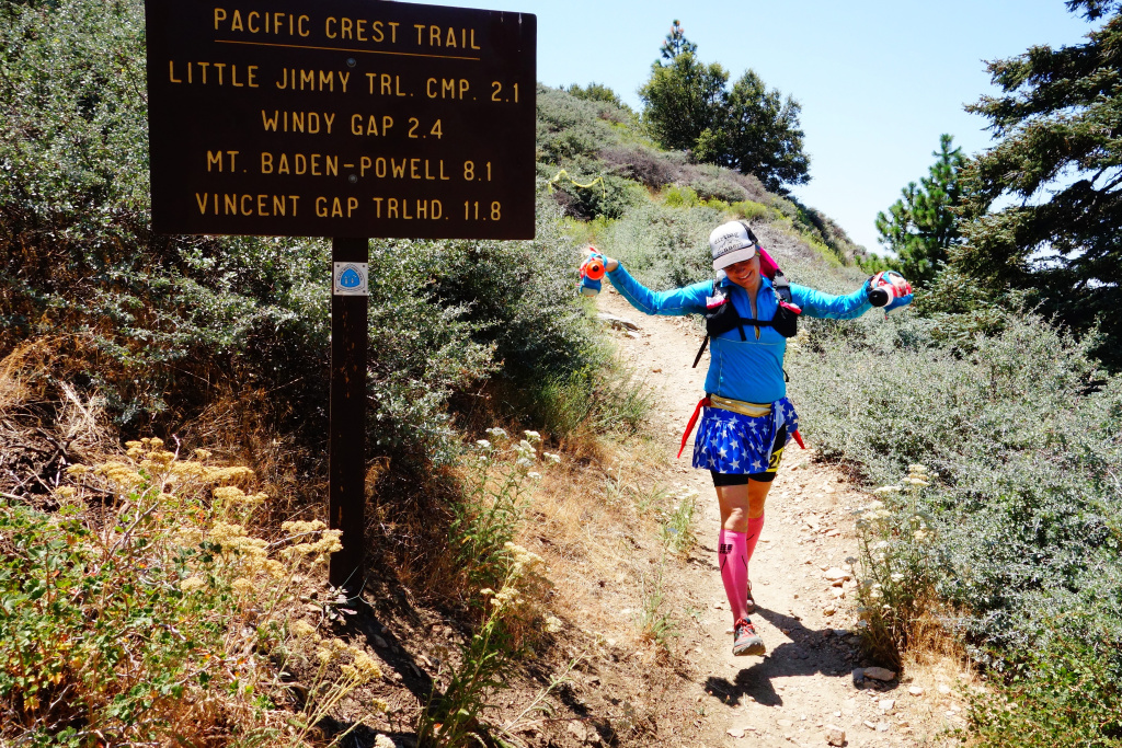 Ultrarunner Martine Sesma descends the Pacific Crest Trail as she completes mile 26 of a 100-mile footrace, the Angeles Crest 100.