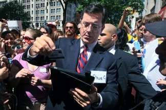 Comedian Stephen Colbert scans a credit card for a donation after attending a Federal Election Commission (FEC) hearing to ask for a media exemption to create a political action committee (PAC) on June 30, 2011 in Washington, DC. Colbert was given the go ahead from the FEC to launch a super political action committee to raise unlimited amounts of campaign cash for the upcoming 2012 political season.