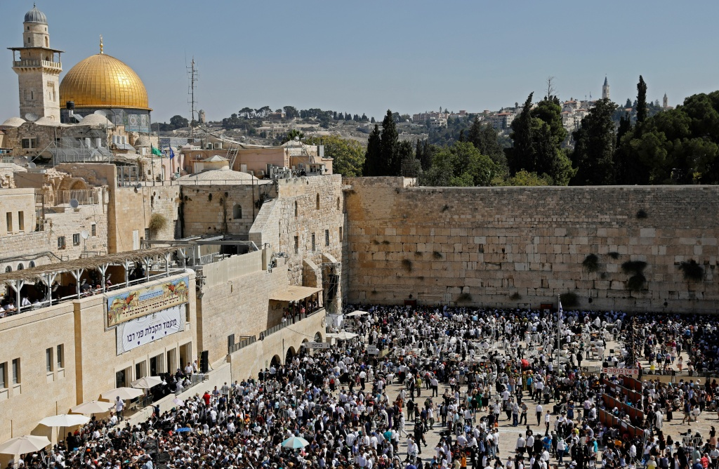 Jewish worshippers perform prayers during the holiday of Sukkot (the Feast of the Tabernacles) at the Western Wall in the Old City of Jerusalem on September 26, 2018.