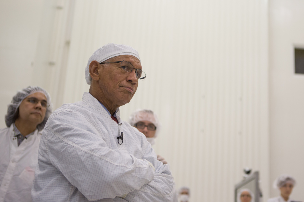 NASA Director Charles F. Bolden, Jr., listens during a tour of the clean room for assembling space vehicles at the Jet Propulsion Laboratory in La Cañada Flintridge, Calif.