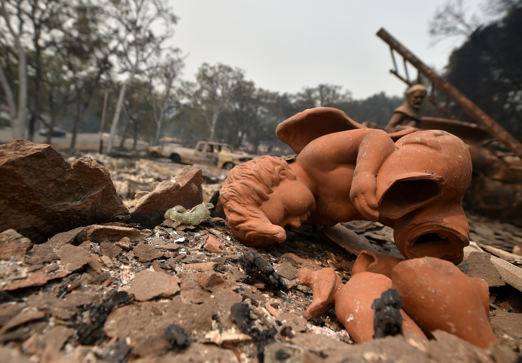 A broken angel statue sits amidst rubble from a burned out house in the Valley Fire in Middletown, California on September 13, 2015. The governor of California declared a state of emergency Sunday as raging wildfires spread in the northern part of the drought-ridden US state, forcing thousands to flee the flames. The town of Middletown, population 1,300, was particularly devastated by the Valley Fire, according to local daily Santa Rosa Press-Democrat, which said the fire grew from 50 acres to 10,000 over just five hours Saturday -- before quadrupling in size overnight.
