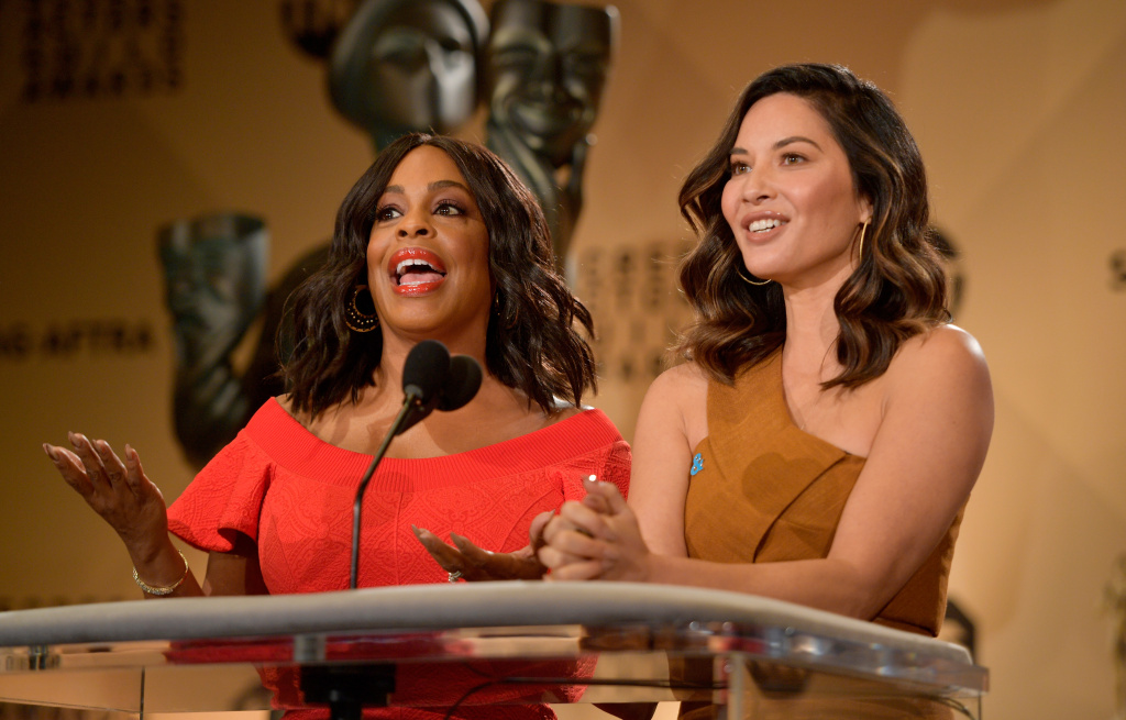 WEST HOLLYWOOD, CA - DECEMBER 13:  Niecy Nash (L) and Olivia Munn speak onstage during the 24th Annual SAG Awards Nominations Announcement at SilverScreen Theater at the Pacific Design Center on December 13, 2017 in West Hollywood, California.  (Photo by Matt Winkelmeyer/Getty Images)