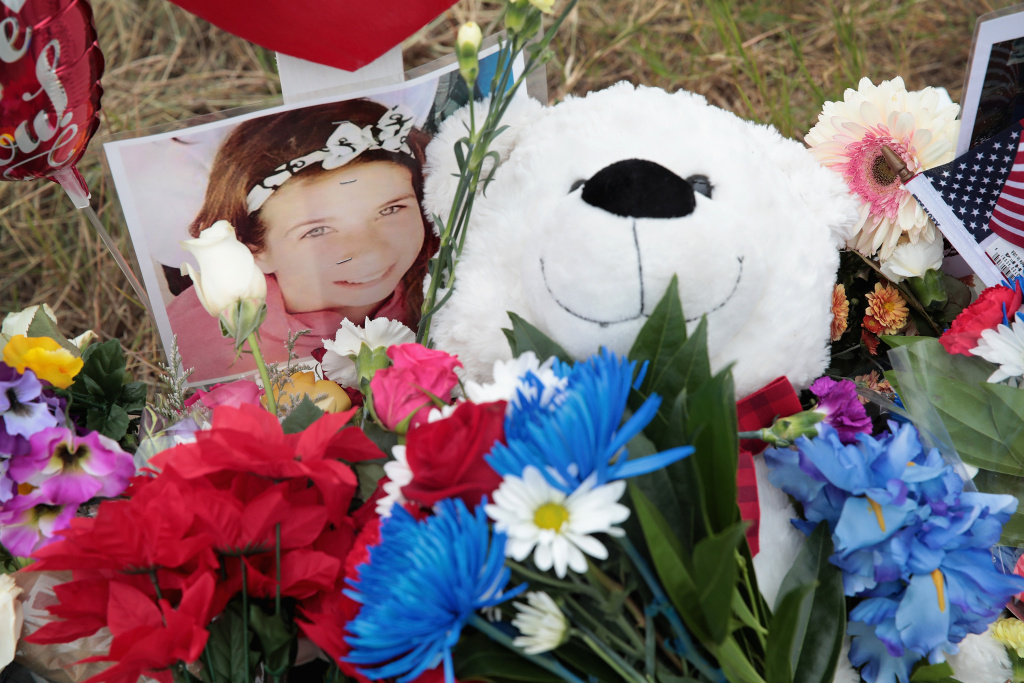 A Teddy bear and a photograph lay at the foot of a cross honoring 16-year-old Haley Krueger at a memorial to honor the 26 people killed at the First Baptist Church of Sutherland Springs on November 5, 2017 in Sutherland Springs, Texas.