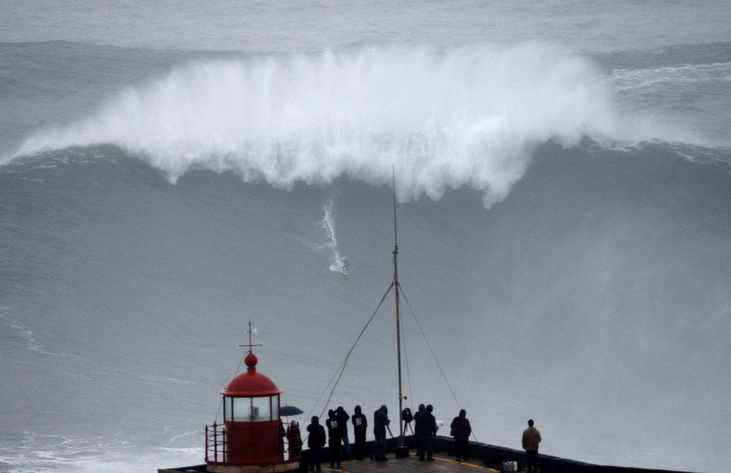 Brazilian big wave surfer Carlos Burle rides a wave in Nazare, central Portugal, on October 28, 2013.