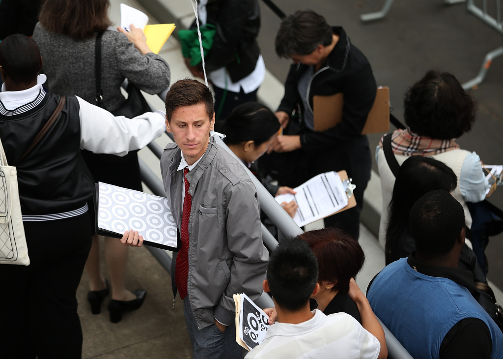 Job seekers wait in line to enter a job fair at a new Target retail store on August 15, 2013 in San Francisco, California. The number of Americans applying for unemployment benefits rose last week after reaching the lowest level in 5 ½ years.