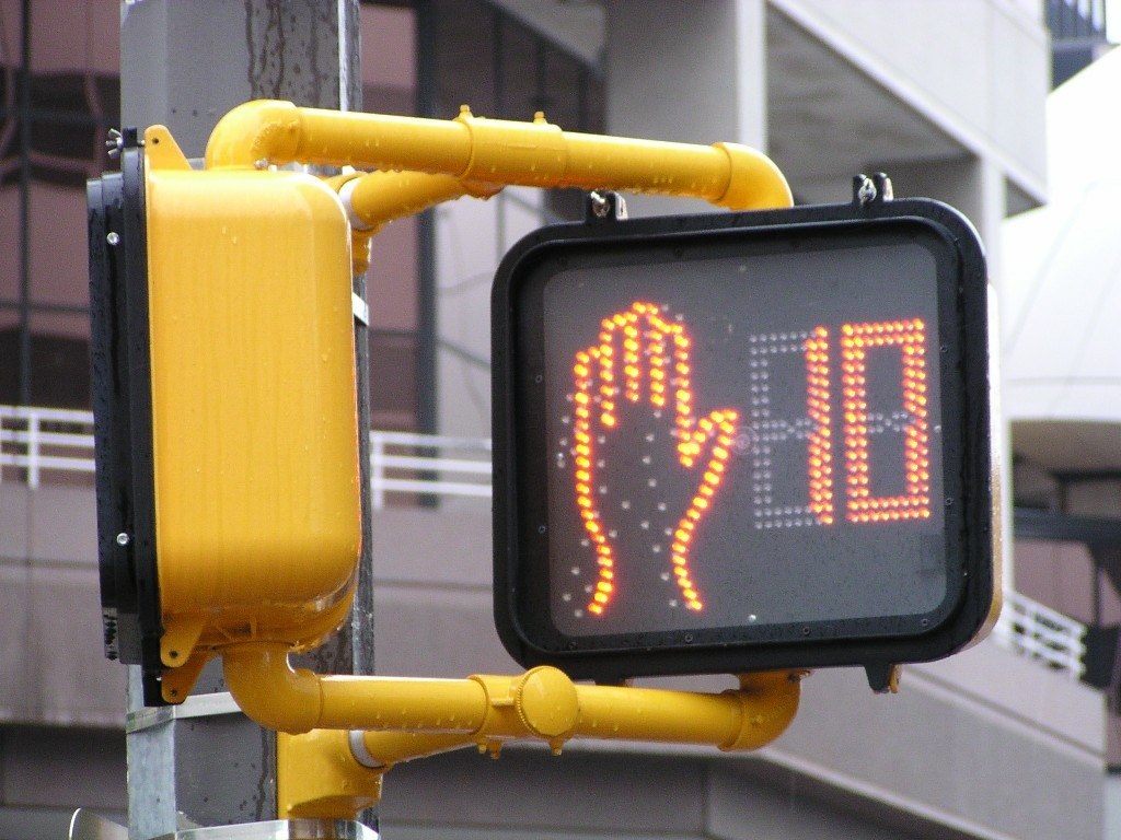 FILE: The California Legislature has voted to change a law that makes it illegal for pedestrians to enter a crosswalk once the countdown timer has begun.