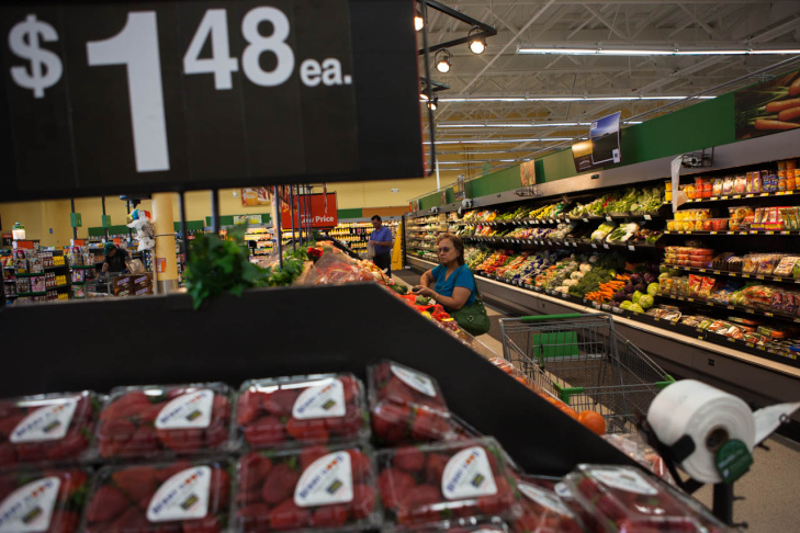A woman shops for produce at a Walmart Neighborhood Market in Santa Maria, Calif. Part of Wal-Mart's advantage is size—the retailer has about 150 stores that sell groceries in California.