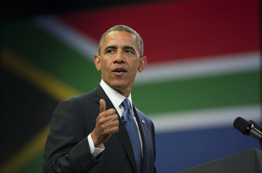 US President Barack Obama speaks during a town hall style meeting at the University of Johannesburg Soweto in Johannesburg, South Africa, June 28, 2013. US President Barack Obama met the family of his 'inspiration' Nelson Mandela but was unable to visit the anti-apartheid legend who remains critically ill in hospital.