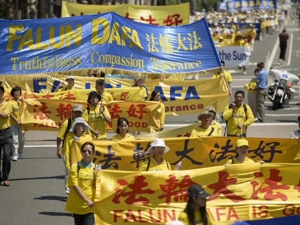 Falun Gong supporters marched from Capitol Hill to the Washington Monument in July 2015 in Washington, DC.
