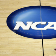 In this March 26, 2014, file photo, Wisconsin's Traevon Jackson dribbles past the NCAA logo during practice at the NCAA men's college basketball tournament in Anaheim, Calif.
