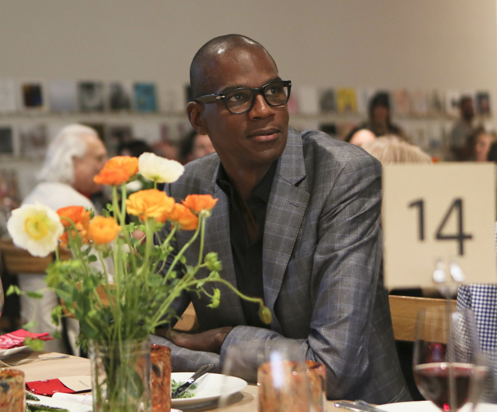 Artist Mark Bradford watches the program during the 2014 Santa Monica Museum of Art PRECOGNITO Gala on April 23, 2014, in Santa Monica, Calif. On Wednesday, October 23, 2014, the Los Angeles Museum of Contemporary Art announced Bradford had been elected to its board of trustees.