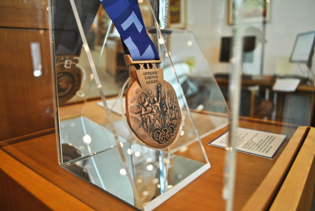 Medals and torches are shown in display through out the Sports Library in LA84 Foundation. This medal is from the 2002 Winter Olympic games held in Salt Lake City, Utah.