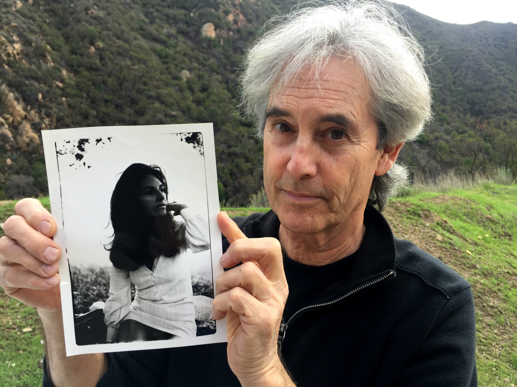 Stephen Seemayer and a photo of his mom, Lynne Westmore Bloom, who died Friday at the age of 81. She painting the famous/infamous Pink Lady on the cliff above the Malibu Canyon tunnel.