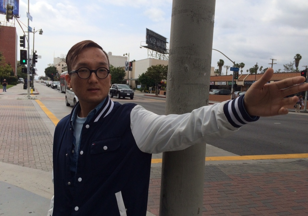 Steve Han stands on a busy street corner in Koreatown, Los Angeles, where he says the local community is addressing underage drinking among youth.