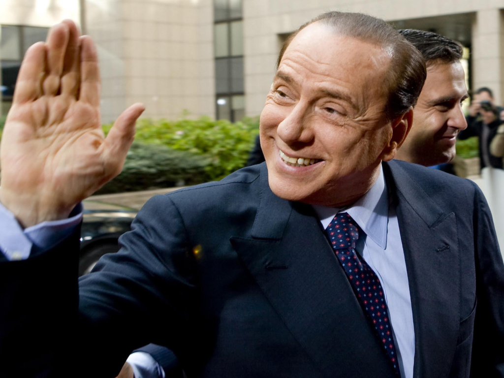 Former Italian Prime Minister Silvio Berlusconi waving at  members of the media in Rome, Italy, in 2011. Berlusconi's staff announced Wednesday that he has tested positive for coronavirus but is showing no symptoms at present.