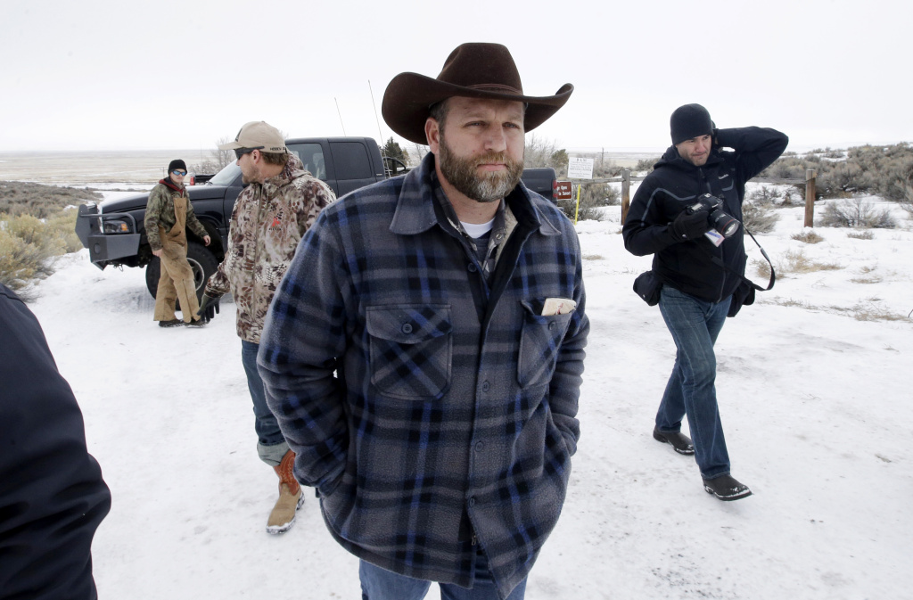 Ammon Bundy, one of the sons of Nevada rancher Cliven Bundy, arrives for an interview at Malheur National Wildlife Refuge, Tuesday, Jan. 5, 2016, near Burns, Ore. Law enforcement had yet to take any action Tuesday against a group numbering close to two dozen, led by Bundy and his brother, who are upset over federal land policy. (AP Photo/Rick Bowmer)